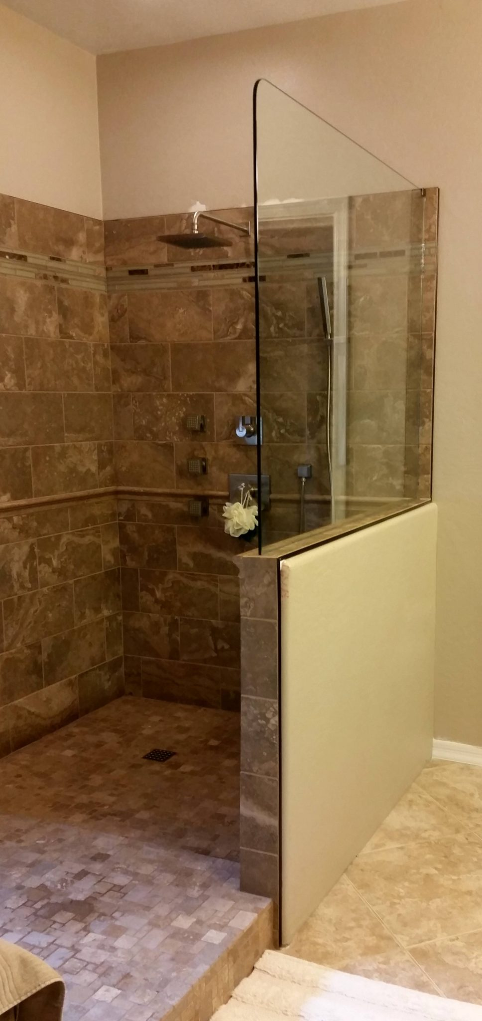 Bathroom Knee Wall splash guard on knee wall | a cut above glass