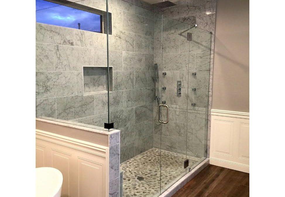 Frameless walk in shower enclosure installed in this modern ...